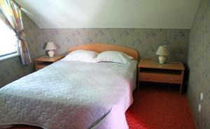 A bed or beds in a room at Rivaal Guesthouse-Cafe