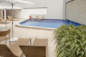 The swimming pool at or close to Internacional Palace Hotel