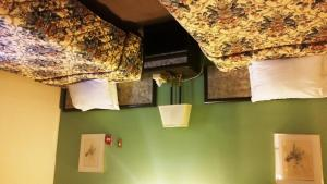 A bed or beds in a room at A Voyageur's Guest House