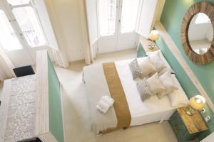 Cama o camas de una habitación en Living4Malaga Suites Superior