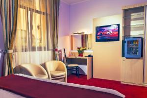 A television and/or entertainment center at Hotel Trianon
