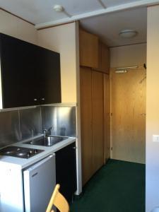 Una cocina o zona de cocina en Appartamento Alpe di Siusi