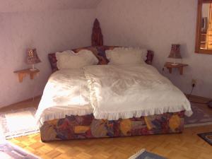 Cama o camas de una habitación en Ferienwohnung Lucia Huber
