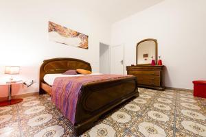 A bed or beds in a room at Casa Vacanze Doria