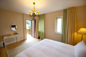 A bed or beds in a room at Mir Boutique Hotel