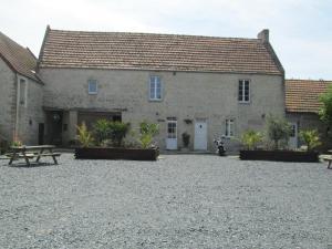 A porch or other outdoor area at La Ferme de la Petite Noé