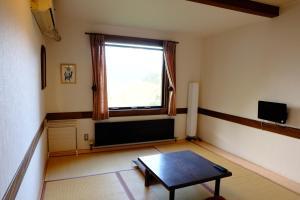 Area tempat duduk di Guesthouse Sakuya