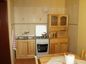 Kuchnia lub aneks kuchenny w obiekcie Rancho Tenisowe