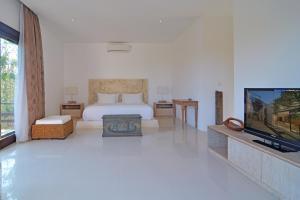 Tempat tidur dalam kamar di The Scene Estate