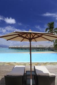 The swimming pool at or near Sofitel Kia Ora Moorea Beach Resort