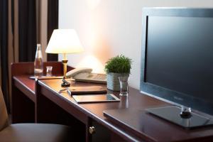 Телевизор и/или развлекательный центр в Hotel Kristall
