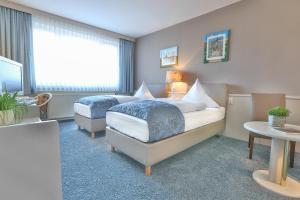 Кровать или кровати в номере Hotel Kristall
