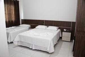 Um quarto em Miotto Executive Hotel