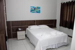Cama ou camas em um quarto em Miotto Executive Hotel