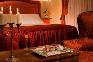 Ein Bett oder Betten in einem Zimmer der Unterkunft Hotel Bonvecchiati