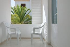 A balcony or terrace at Hostal Capri