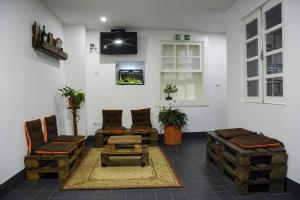A seating area at inBraga Hostel