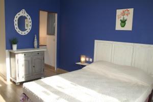 Un ou plusieurs lits dans un hébergement de l'établissement Chambres d'hôtes Le Puid de Gauthier