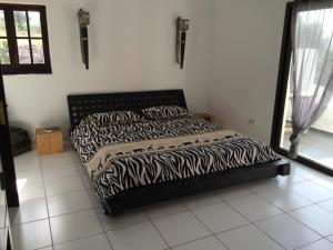 A bed or beds in a room at Casa Colina