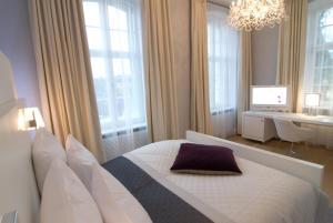 Ein Bett oder Betten in einem Zimmer der Unterkunft Hotel Ketschauer Hof