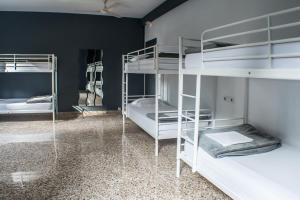 A bunk bed or bunk beds in a room at Quart Youth Hostel & Apartments