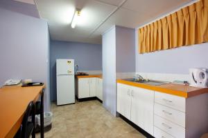 A kitchen or kitchenette at Vale Hotel