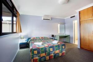 A bed or beds in a room at Vale Hotel
