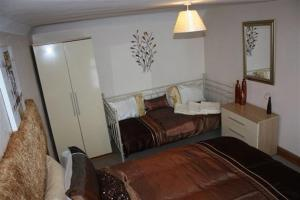 A bed or beds in a room at Robertsbridge Retreat At Cornhill Luxury Self Catering Apartments