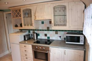 A kitchen or kitchenette at Robertsbridge Retreat At Cornhill Luxury Self Catering Apartments
