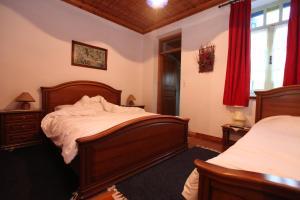 Ένα ή περισσότερα κρεβάτια σε δωμάτιο στο Τυμφαία Έπαυλη