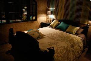 Un ou plusieurs lits dans un hébergement de l'établissement Guesthouse Kathome