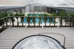 The swimming pool at or near Altis Grand Hotel