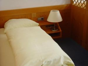 A bed or beds in a room at Gasthof zur Sonne