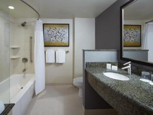 A bathroom at Courtyard by Marriott Montreal Airport