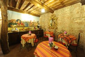 A restaurant or other place to eat at Antica Corte dei Principi