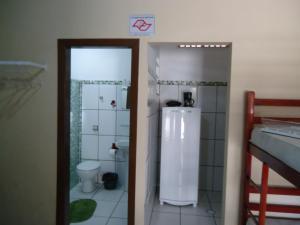 Um banheiro em Pousada do Beto