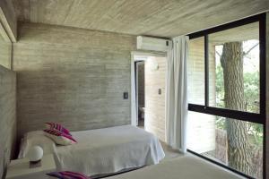 A bed or beds in a room at V & D - Casas en Mar Azul