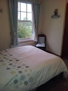 A bed or beds in a room at Bed and Breakfast Ashfield