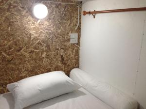 A bed or beds in a room at Chiangmai Gate Capsule Hostel Dormitory