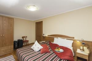 Postel nebo postele na pokoji v ubytování Residence Livigno MyHolidayLivigno