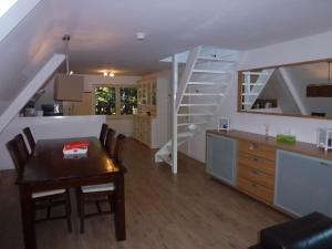 A kitchen or kitchenette at Schiphol Apartments