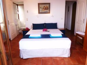 Ένα ή περισσότερα κρεβάτια σε δωμάτιο στο Milia Bay Hotel Apartments