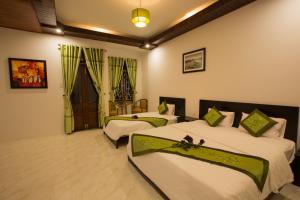 Ein Bett oder Betten in einem Zimmer der Unterkunft The Village Homestay