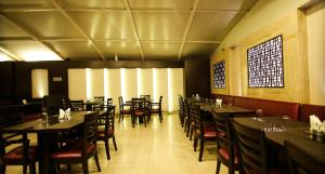 A restaurant or other place to eat at The Prime Balaji Deluxe @ New Delhi Railway Station