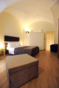 A bed or beds in a room at Negramaro Suite B&B