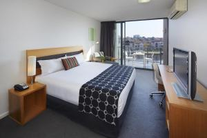 A bed or beds in a room at The Sebel East Perth