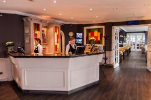 The lobby or reception area at Golden Tulip Leiden Centre