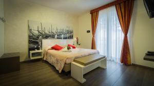Postel nebo postele na pokoji v ubytování Hotel Venezia