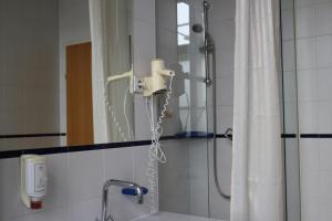 Ванная комната в Hotel Kolbeck am Columbusplatz
