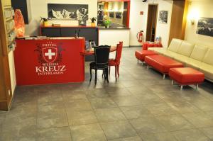 Lobby/Rezeption in der Unterkunft Hotel Weisses Kreuz